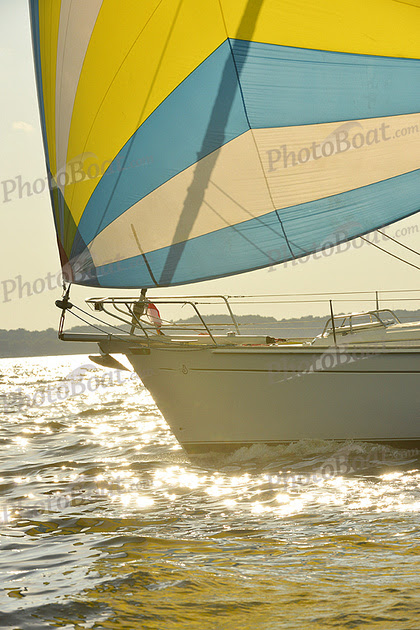 Beneteau 50 with a Top Down furler and removable bow sprit under sail. Thanks to Photo Boat.